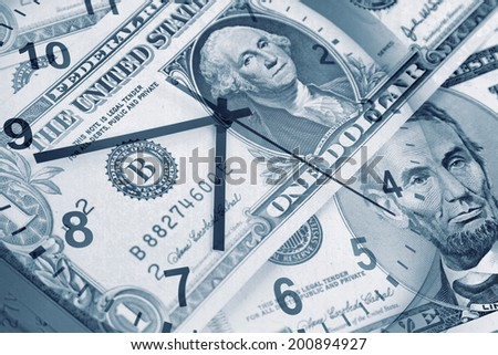 American banknotes and clock. Time is money concept  - stock photo