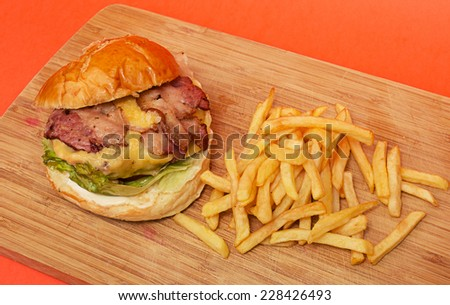 American burger with bacon and french fries - stock photo