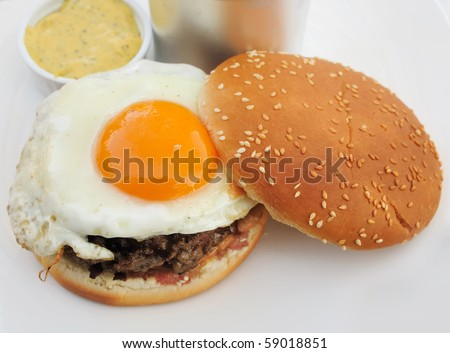 American burger with egg - stock photo