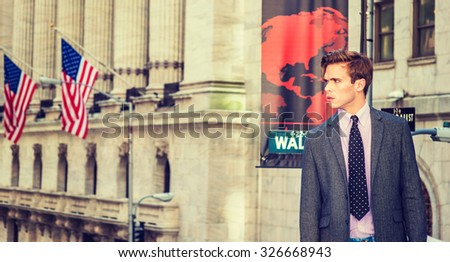 American businessman in New York. Young college student, wearing blazer, necktie, standing by vintage style office building with American flags, confidently looking forward. Instagram filtered effect. - stock photo