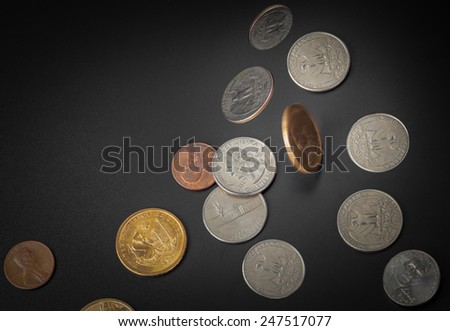 American coin falling on black background - stock photo