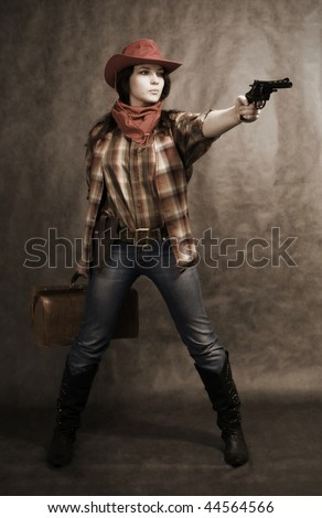 American cowgirl in a western movie style - stock photo