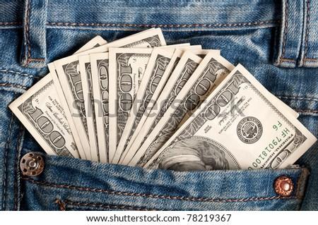 american dollar bills in jeans pocket background - stock photo