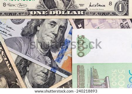 American dollars and Uzbek money - stock photo