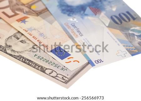 American dollars, European euro,Swiss franc currency - stock photo