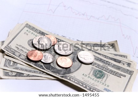 American dollars on top of a financial graph. Focus on money. - stock photo