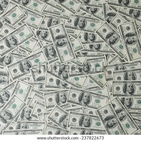 american dollars pile as background by hundreds of dollars bills - stock photo