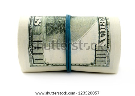 American dollars rolled up on white background - stock photo