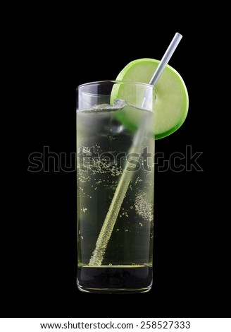 American Dream Drink, consisting of bourbon, apple schnapps and lemon-lime soda. Isolated on black background - stock photo