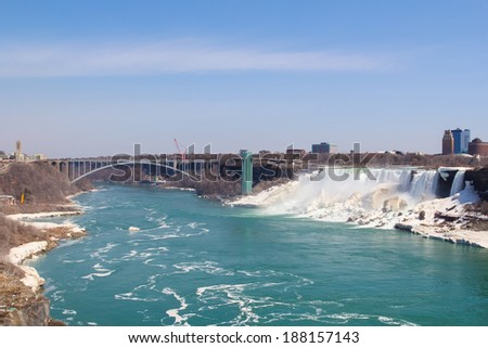 American Falls and the border crossing bridge between Canada and USA - stock photo