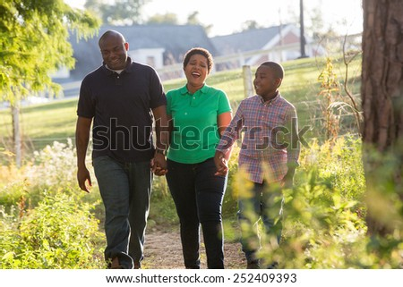 american family posing together in a nice park - stock photo