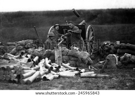 American Field Artillery on the Lorraine front in Beaumont, France. An ejected shell case flies through the air as a new shell is put into the breech in the same a second. WWI. Sept. 12, 1918. - stock photo
