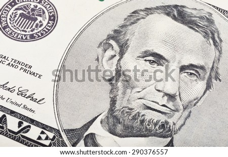 American five dollar banknote detail - stock photo