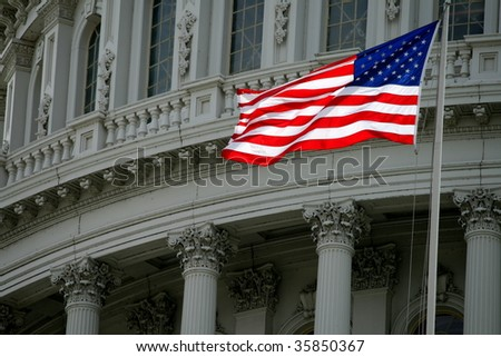 American Flag Against the Capitol Dome - stock photo