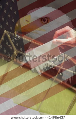 American flag, american eagle and hand putting a blank ballot inside the box, concept of American elections - stock photo
