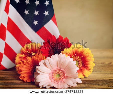 American flag and a bouquet of flowers close-up - stock photo