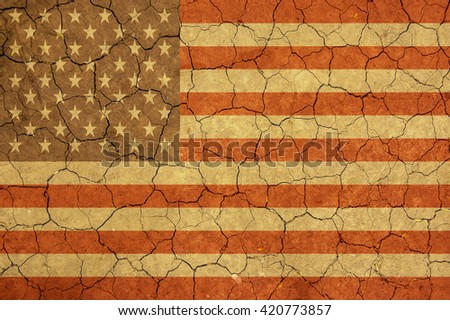 American flag  and dry earth surface background - stock photo