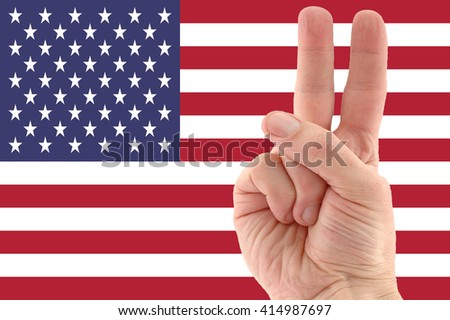 American flag and victory hand sign  - stock photo