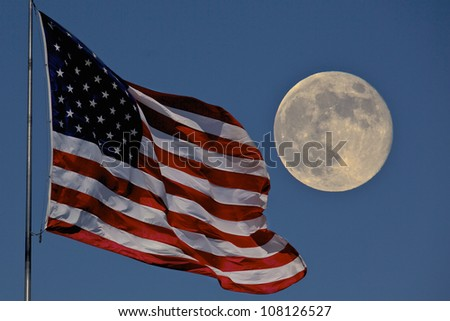 American flag flying and a full Moon background - stock photo