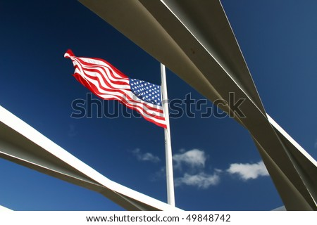 American flag flying on the Arizona Memorial at Pearl Harbor, Hawaii. - stock photo