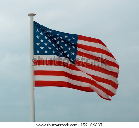 American flag from Promenade des Anglais, Nice, France. - stock photo