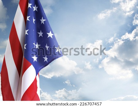 American flag in blue sky - stock photo