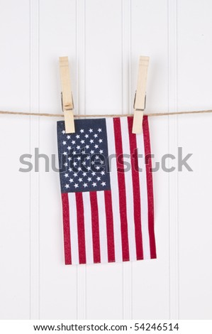 American Flag on a Clothesline Hanging Against a White Background. - stock photo