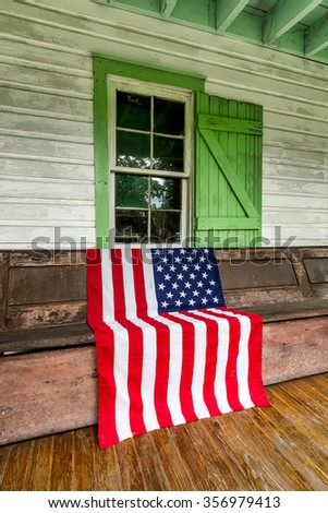 American flag on display at old homestead - stock photo