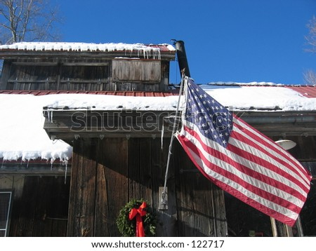 American flag on house, Vermont. - stock photo