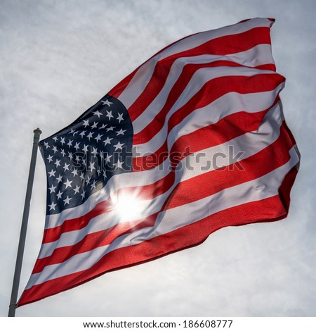 american flag on sky background - stock photo