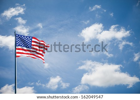 American flag on the blue sky - stock photo