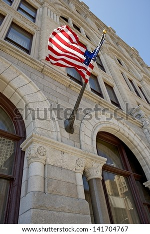 American Flag on the Building. U.S.A. Flag. - stock photo