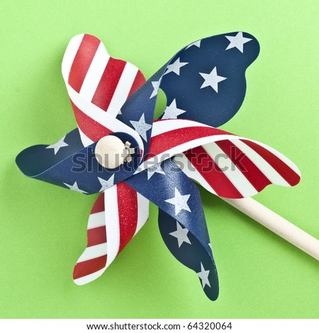 American Flag Patriotic Pinwheel on a Vibrant Green Background. - stock photo