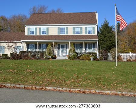 American Flag pole Beautiful Suburban Sunny Clear blue Sky Residential Neighborhood USA - stock photo