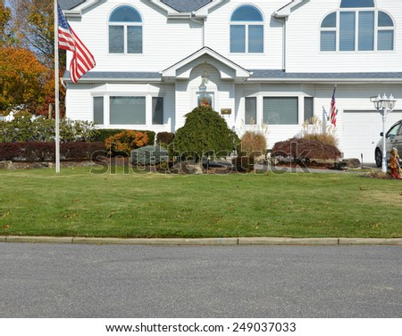 American flag pole closeup view of suburban mcmansion autumn day residential neighborhood USA - stock photo