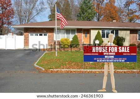 American flag pole Mannequin holding Real estate for sale open house welcome sign suburban brick ranch style home white picket fence blacktop driveway autumn blue sky day residential neighborhood USA - stock photo