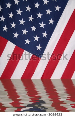 American flag reflected in water with ripples - stock photo