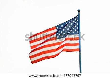 American flag waving on flagpole, isolated white background - stock photo