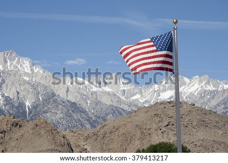 American Flag with Mt Whitney in the background.  - stock photo