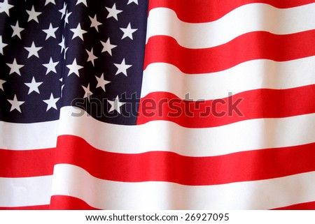 American flag with special lighting to make it look as if the wind was blowing and making it wave. - stock photo