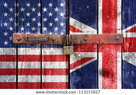 American flag with the UK flag on the background of old locked doors - stock photo
