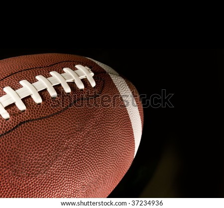 American football again black background - stock photo