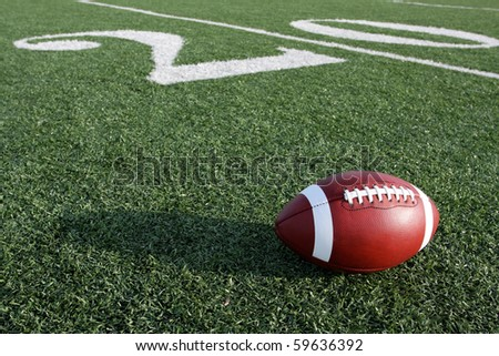 American Football along the Twenty Yard Line of the field - stock photo