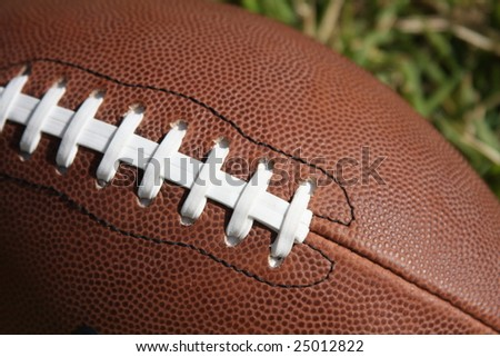 American football and laces - stock photo