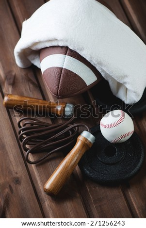 American football and other various sports equipment, close-up - stock photo