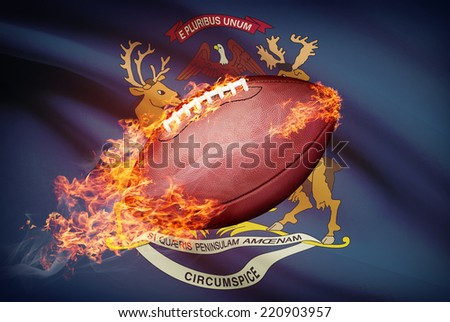 American football ball with flag on background series - Michigan - stock photo