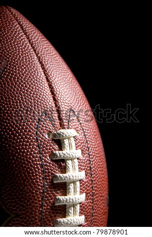 American football, black background, copy space - stock photo