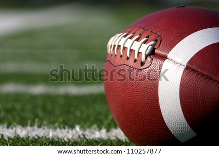 American Football Close up on Field with yard lines in the distance - stock photo