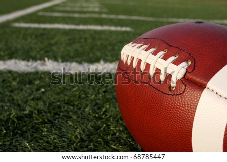 American Football close up with yard lines - stock photo