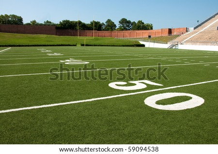 American football field with goal post in background. - stock photo